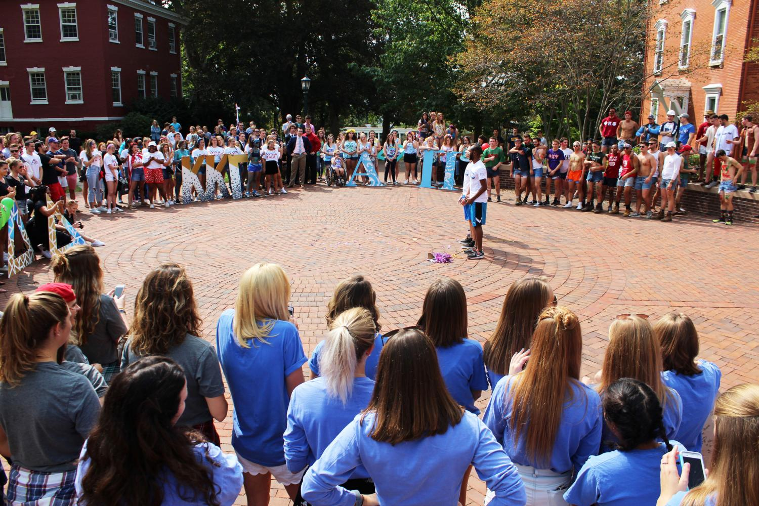 The+college+community+gathers+to+watch+the+brothers+of+Phi+Beta+Sigma.+