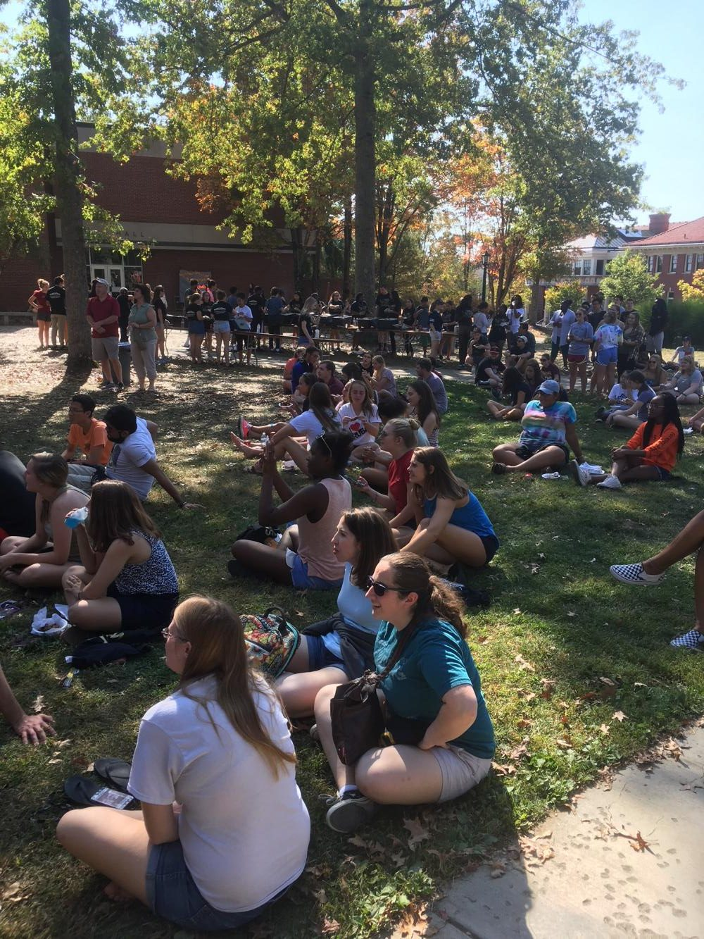 Members of the Allegheny community watch the wing-eating competition on the Gator Quad.