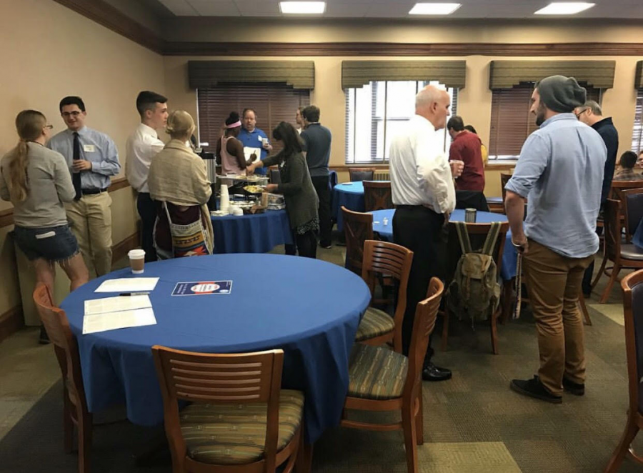 Local candidates discuss platforms with students during the meet and greet hosted by the College Democrats in Schultz East Alcove on Thursday, Oct. 19, 2017.