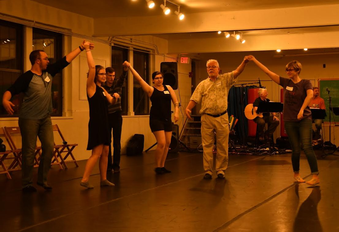 Brian How of Edinboro provides a waltz lesson to Allegheny College students at the contra dance in Montgomery Hall on Oct. 28, 2017.