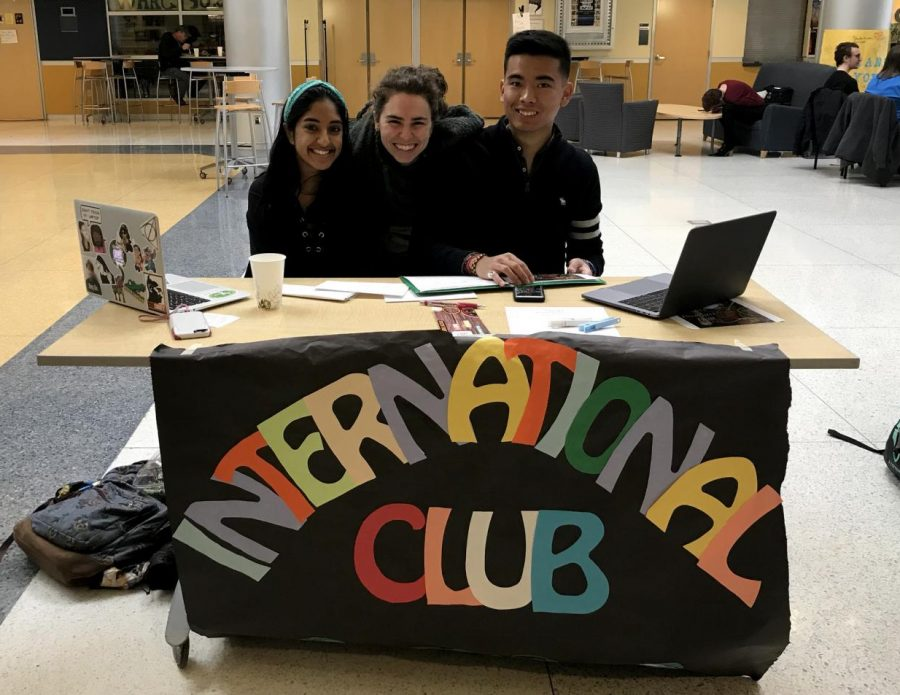 Members of the International Club, Sambrita Mally, '20, Maggie Dugan, '18, and Shashank Shrestha, '19, table for International Education Week in the Henderson Campus Center on Wednesday, Nov. 15, 2017.