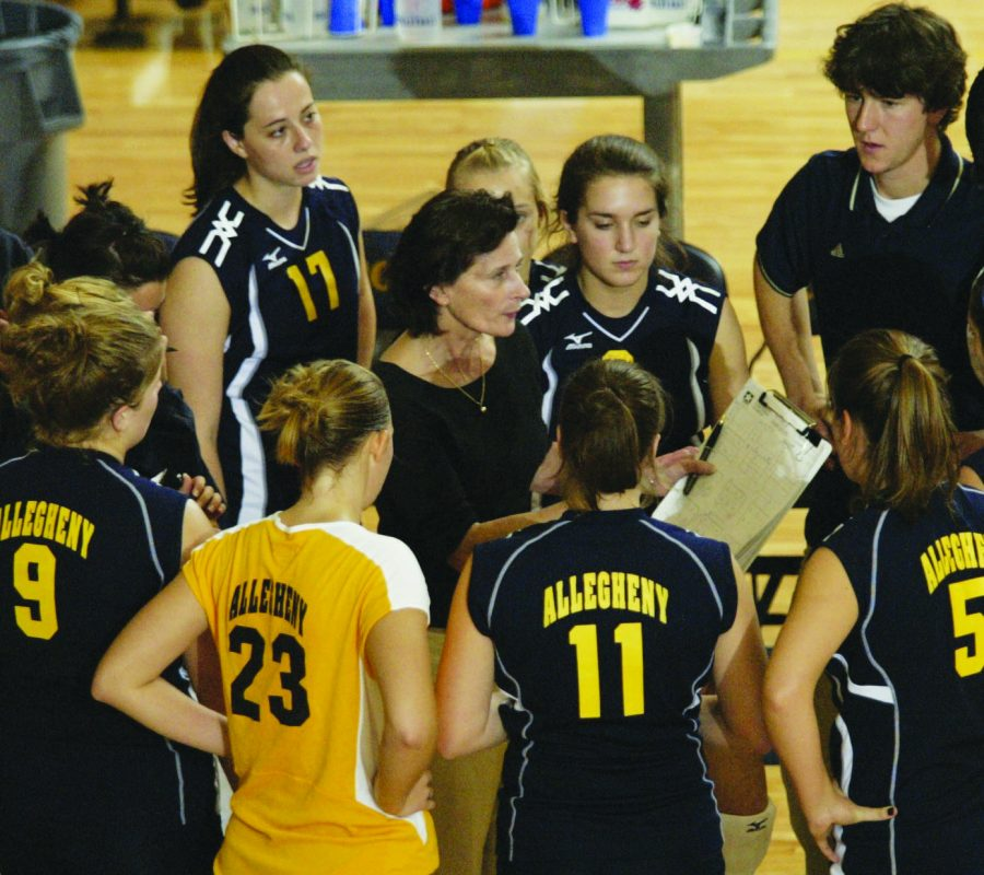 Allegheny College Women's Volleyball Head Coach Bridget Sheehan stands in the middle of the team's huddle during a game against Ohio Wesleyan University on Oct. 20, 2006.