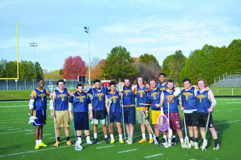 The men's lacrosse club team poses for a photo after its game on Oct. 29, 2017 at Edinboro University.