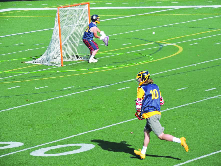 Jack Dudo, '18, makes a save during the lacrosse game against Edinboro.