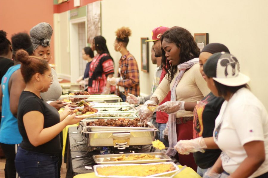 Association for the Advancement of Black Culture members serve food at the Soul Food Dinner, an event part of ABC's celebration of Black History Month at Schultz Banquet Hall on Sunday, Feb. 11.
