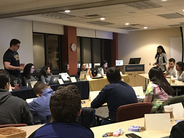 Allegheny Student Government President Mark MacStudy, '18, swears Monessha Jayabalan, '19, into the Class of 2019 Senate during the ASG meeting Tuesday, Feb. 13, 2018.