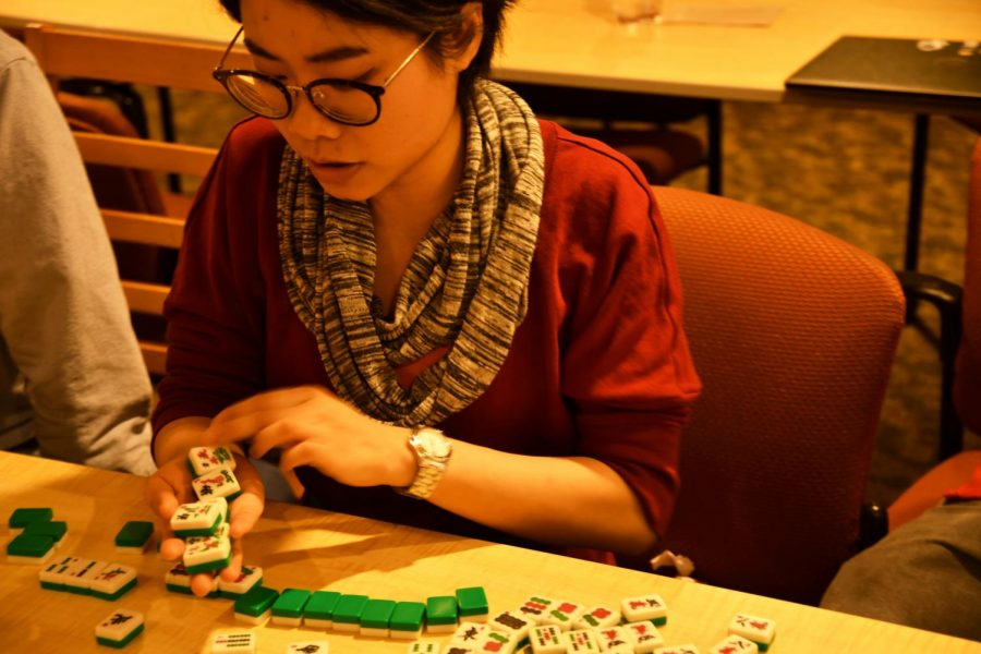 Chih-Jung Chen, Chinese language teaching assistant sets up a mahjong game at the Chinese New Year celebration.