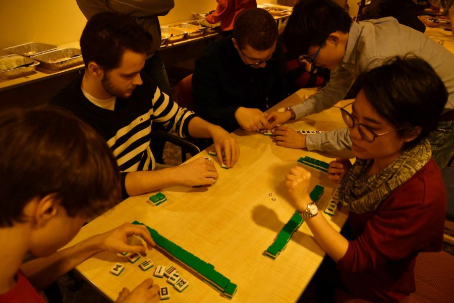 Members of the Chinese American Friendship Society play mahjong.