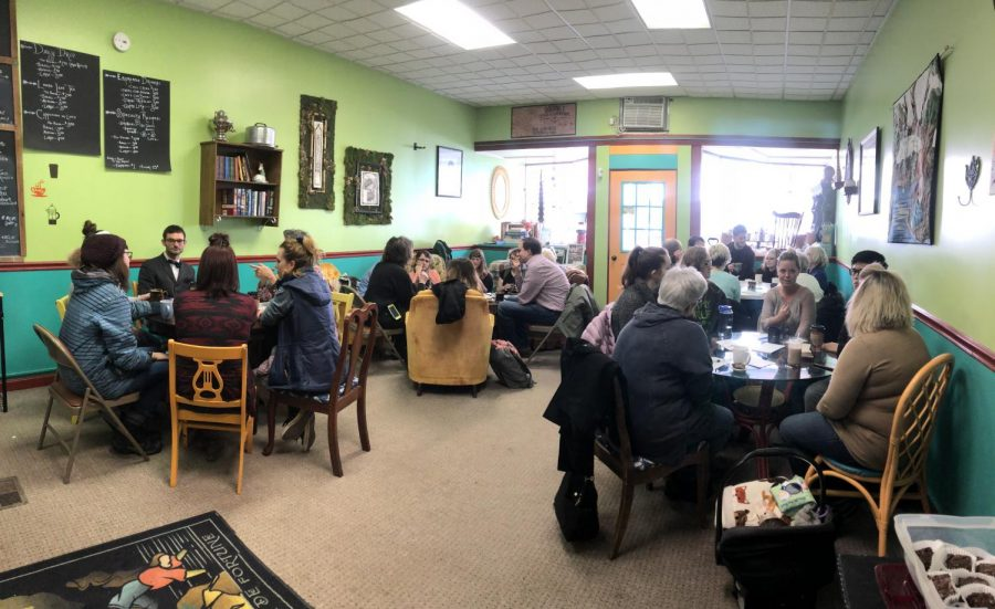 Allegheny students and members of the Meadville community attend an event which started discussions on death and coffee at Tarot Bean Roasting Company on Sunday Feb. 18, 2018.