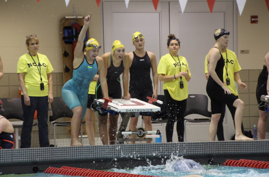 Members of the Allegheny Swim Team cheer on their teammates during Conference Championships on Wednesday, Feb. 14, 2018.