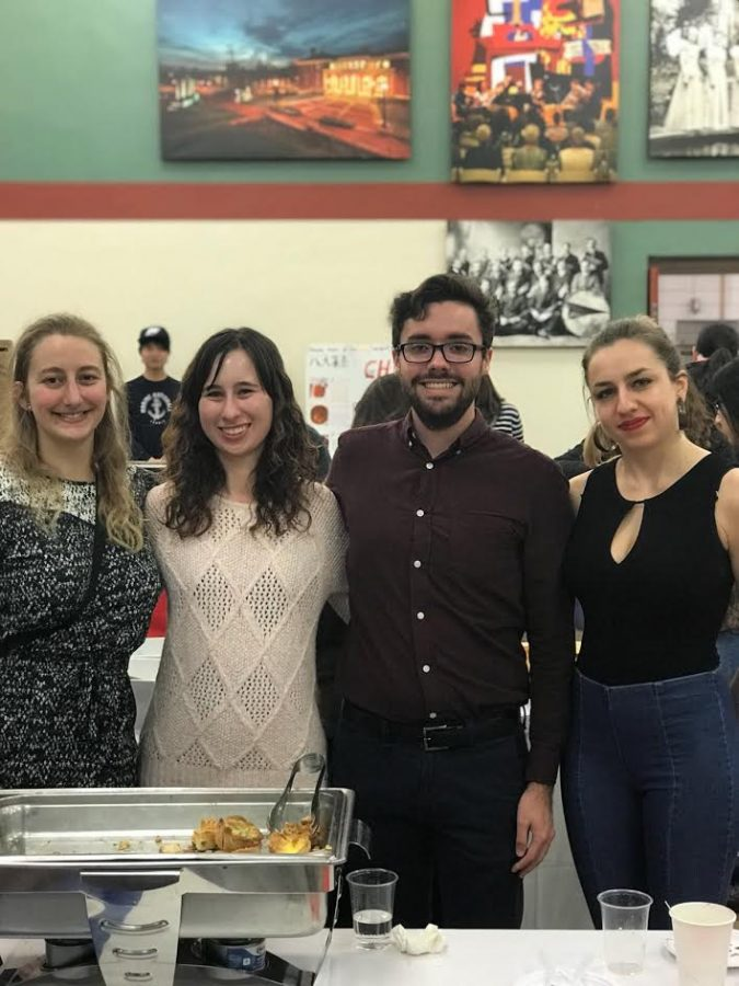 French House residents Charline Bordat, Nicole Popp, '20, and Lucas Proper, '18, pose with French exchange student Pauline Benard at the International Bazaar in Schultz Banquet Hall on Nov. 19, 2017.