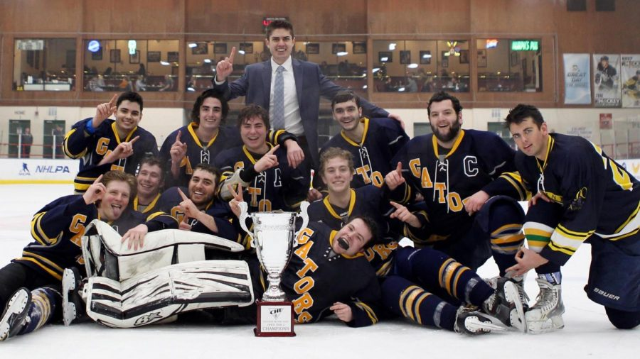 Members of the Allegheny College hockey team pose for a photograph after winning the championship game on Saturday, Feb. 24, 2018.