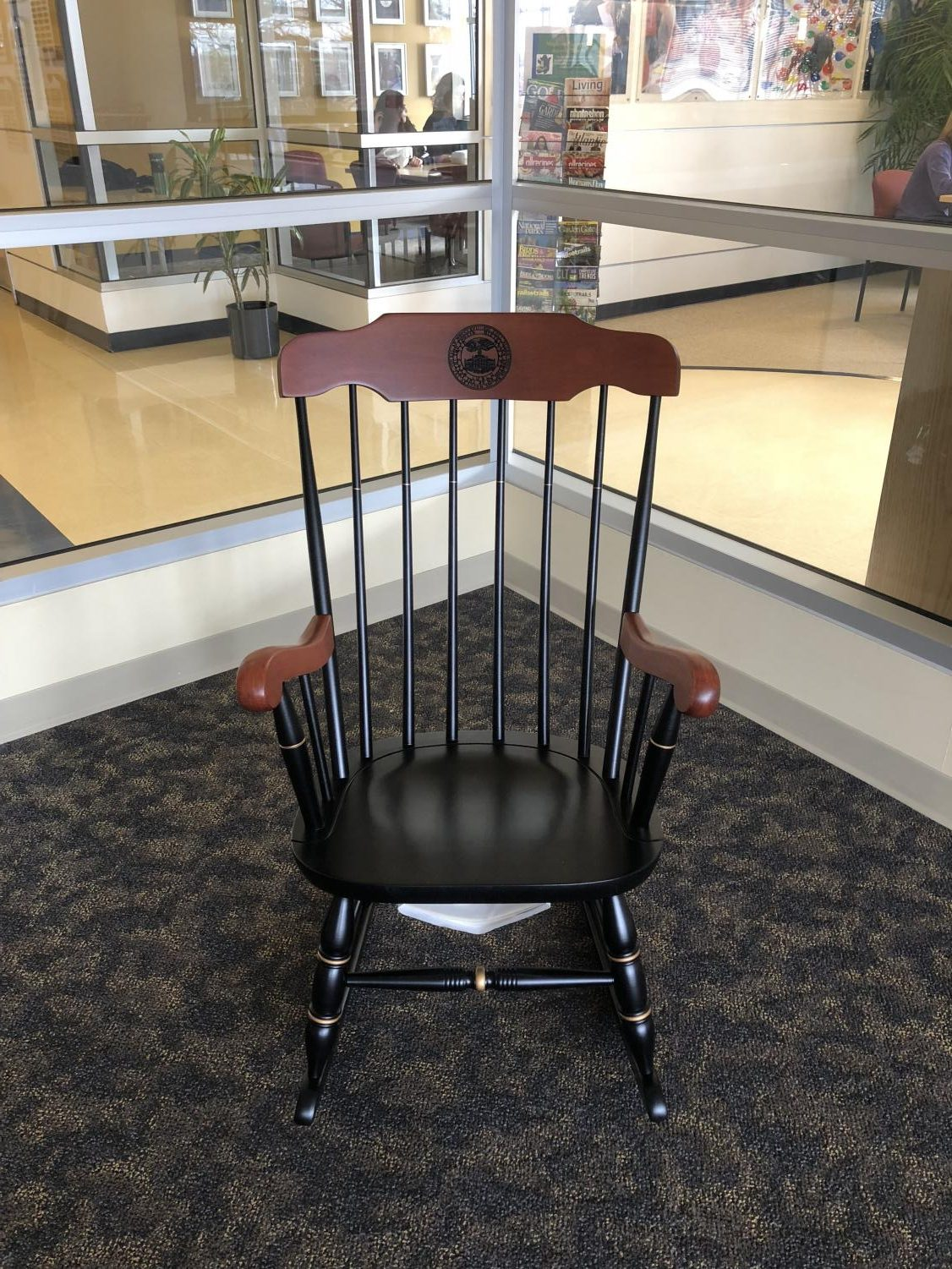 """A chair with the phrase """"be somebody who makes everybody feel like a somebody"""" on the back, dedicated to the memory of Pamela McCurdy is displayed on Saturday, March 3, 2018."""