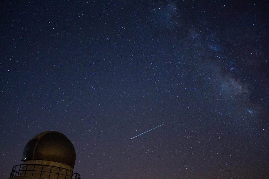At bottom center, a meteor from the Lyrid meteor shower streaks across the sky in Cairo, Egypt on April 25, 2015.