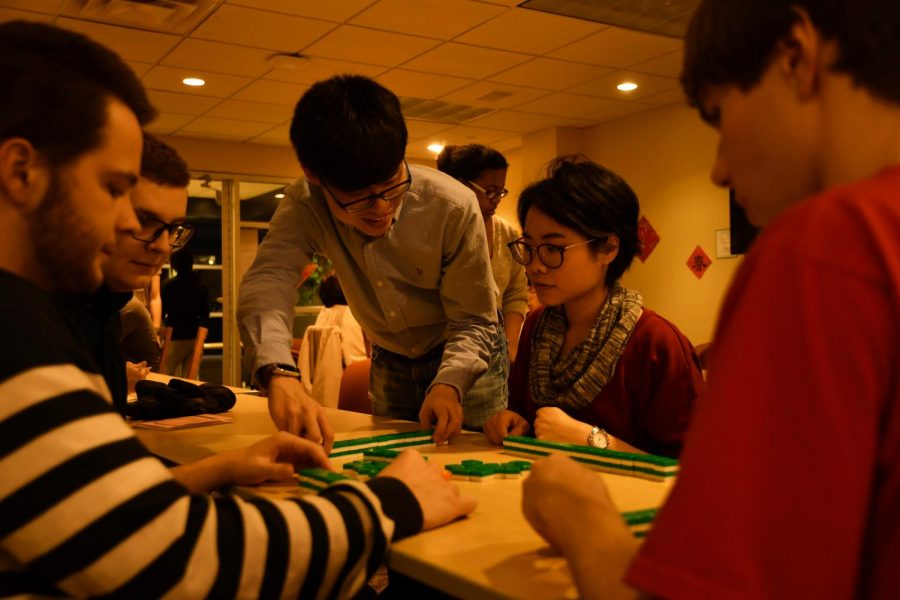 Xingbang Liu, '20, and Chih-Jung Chen, Chinese language teaching assistant, set up mahjong and teach Alec Tolmachoff, '20, Thomas Cassidy, '21, and Malcolm Willig, '21, how to play at the Chinese American Friendship Society's Chinese New Year Celebration on Friday, February 16, 2018.
