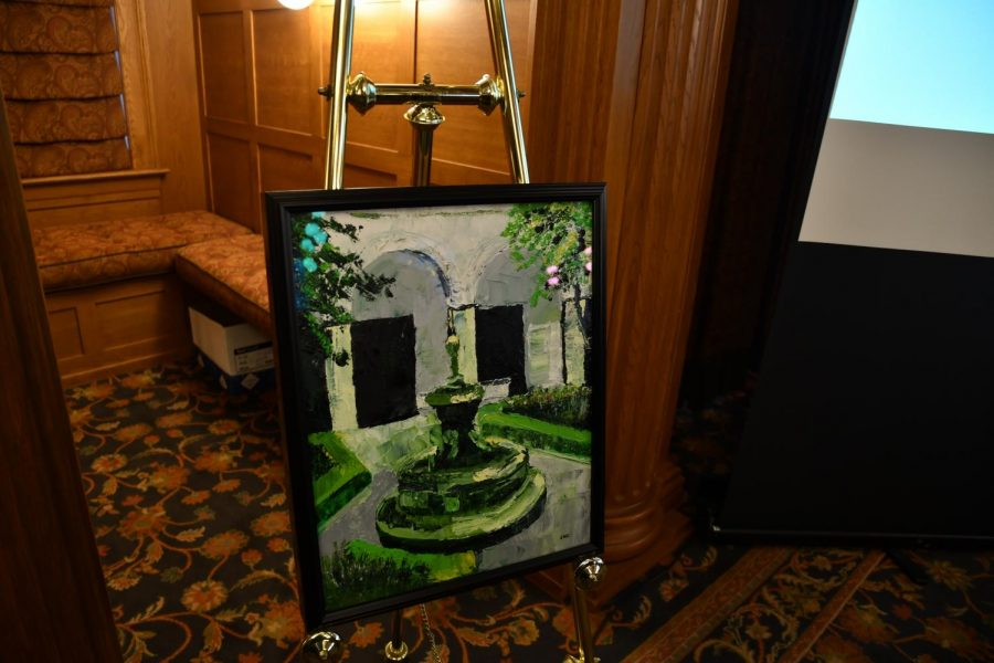John Walton-Cale, 75, spoke about his experiences traveling and painting at the annual Phi Sigma Iota induction ceremony on Tuesday, April 10, 2018.  Walton-Cale displayed photographs and images of his own paintings of places in France, Colombia and Peru. The former Gator has donated a painting to Ruter Hall of the courtyard of the Fernando Botero Museum in Bogota, Colombia.