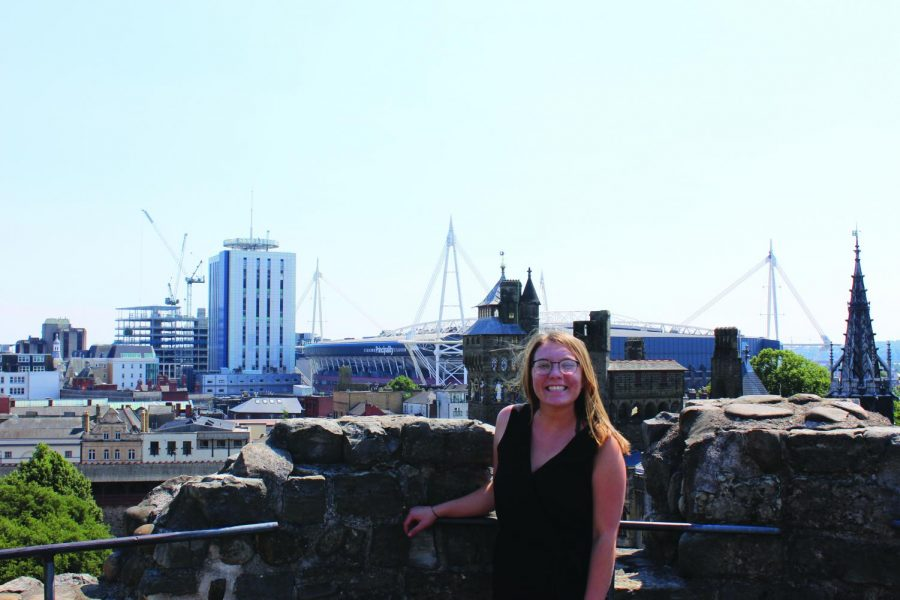 Sarah Shapley, '20, stands atop one of the towers of Cardiff Castle in Cardiff, Wales, on July 5, 2018.