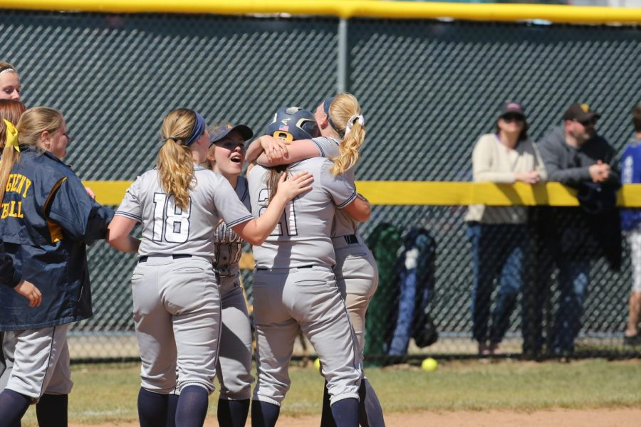 Then-athlete Jessica Zavolta, '18, embraces teammates after a home game against Ohio Wesleyan University on April 22, 2018.