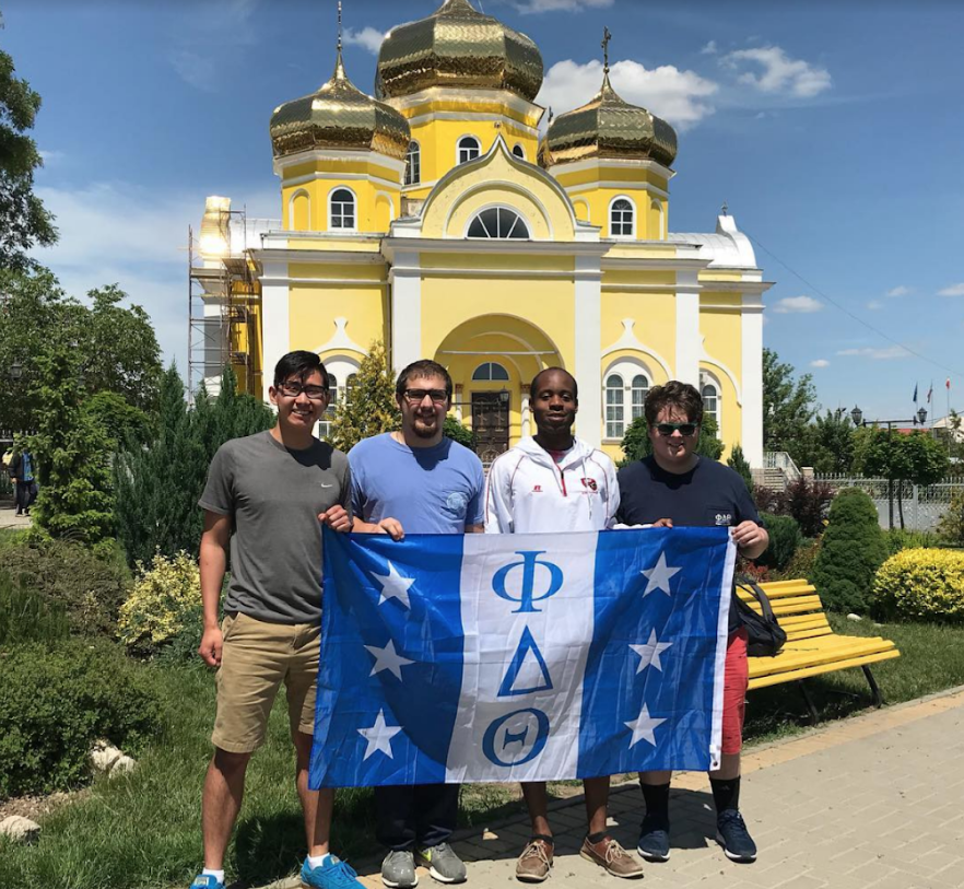 Jon Bumanis, '21, Robbie Phillips, '19, RayShawn Kilgore, Phi Delta Theta Eta chapter member, Sam Zucker, '19, in Gagaux Yeri, Moldova on an Allegheny Experiential Learning trip over the 2018 summer.