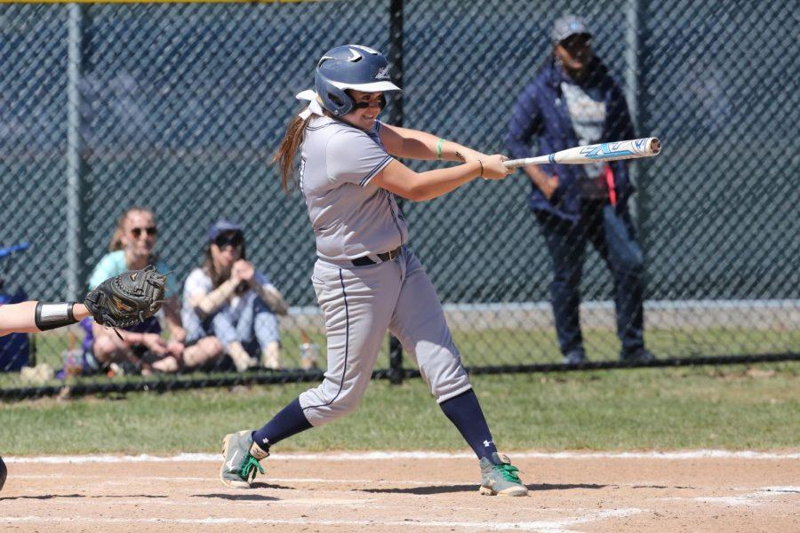 Jessica Zavolta, '18, swings at bat during an April 22, 2018 game against Ohio Wesleyan University.