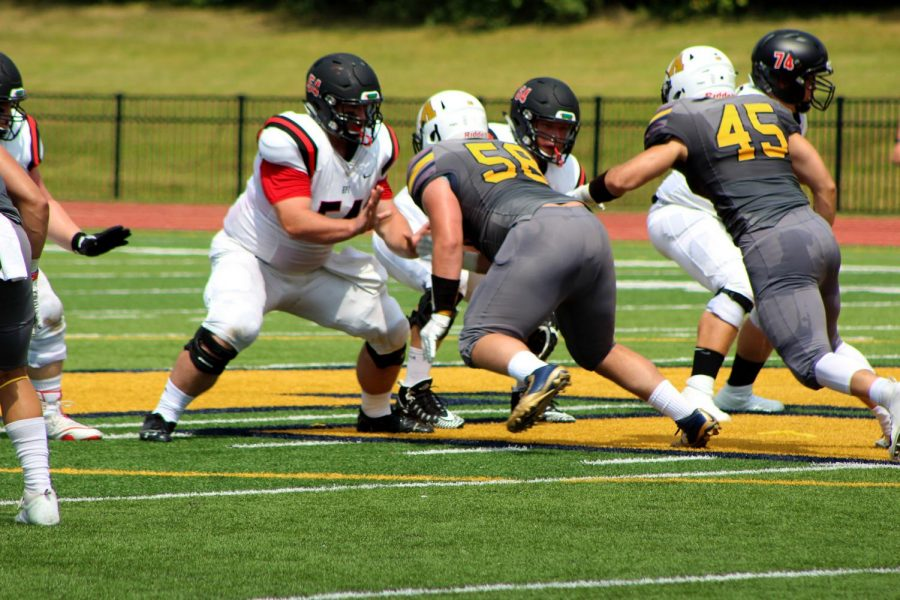 (from left to right) Allegheny defensive lineman Austin Hoyt, '20, and  defensive end Kyle McGee, '20, face off against the Engineers at the 50-yard line.