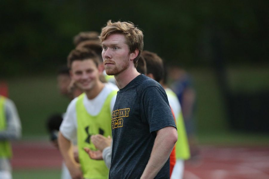 Assistant volunteer men's soccer coach Brendon Hall stands on the field during a practice. Hall has been coaching for Allegheny for five years and also works as the adviser for the Fellowship of Christian athletes.