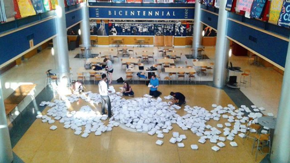 Students for Environmental Action demonstrates the level of McKinley's waste production from compostable to-go boxes on April 15, 2017, in the Henderson Campus Center lobby.