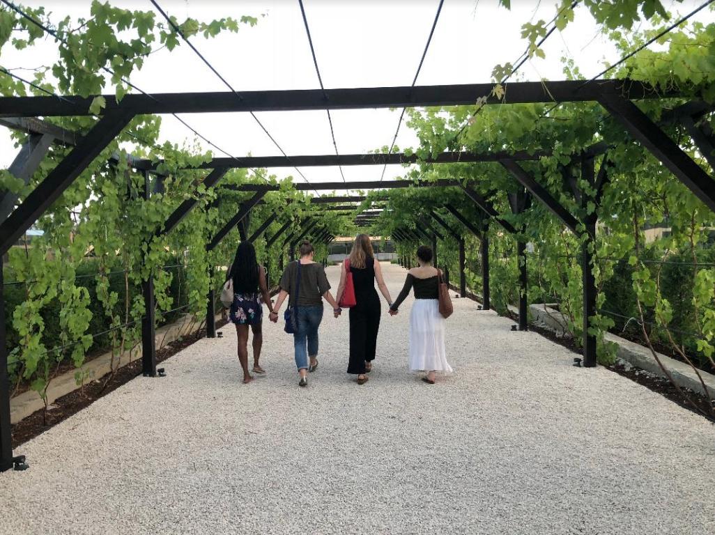 Britiny Hubbard, '19, Margaret Zeller, '20, Madeline Fodor, '20, and Alexa Vargas, '19 walk together at Castle Mimi Winery as part of the 2018 Moldova EL Seminar.