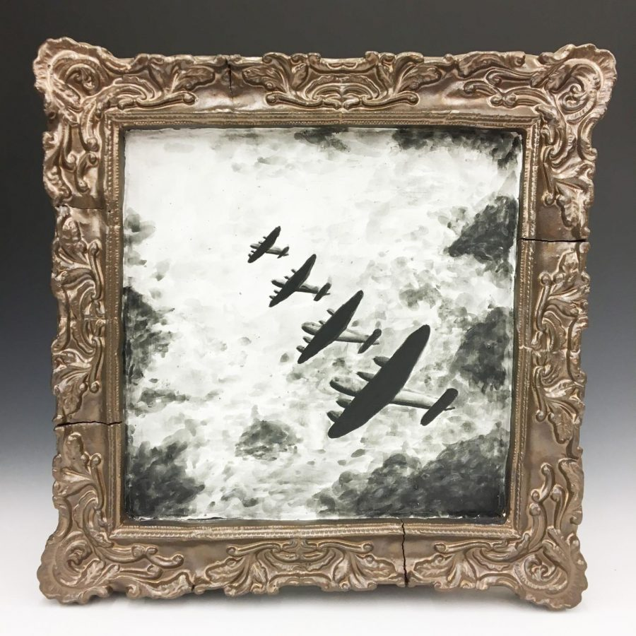 Natalia Buczek, '19, features black and white B-17 flying fortresses painted with under glaze on top of her copper tone ceramic mold.