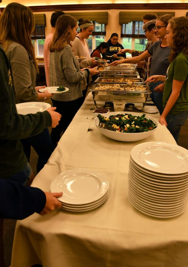 Student volunteers serve guests at the 16th annual DeHart Local Foods Dinner on Wednesday, Sept. 26, 2018, in Schultz Banquet Hall. The menu items were curated by Parkhurst Dining Services based on products from local farmers and producers, including Plot Twist Farm, Crawford County Fungi, Happy Mug Coffee, Tender Acres, Strawberry Lane Produce and Pine Run Farm, among others.