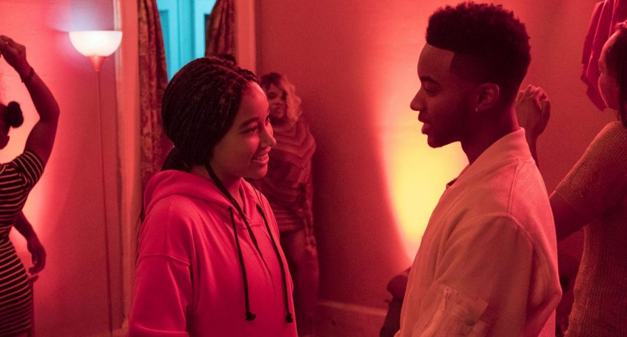 """Starr Carter (Amandla Stenberg) connects with Khalil Harris (Algee Smith) at a house party in Garden Heights the night of the fatal shooting of Harris in """"The Hate U Give,"""" the 2018 film adaptation of Angie Thomas's 2017 young adult novel of the same name."""
