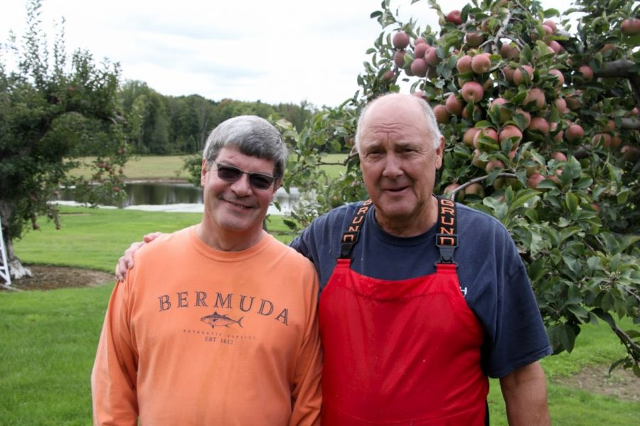Jeff Boswell and Jeff Davenport stand in front of a row of Red Fuji apple trees at Davenport Fruit Farm Cidery and Winery in Meadville on Saturday, Sept. 29, 2018.