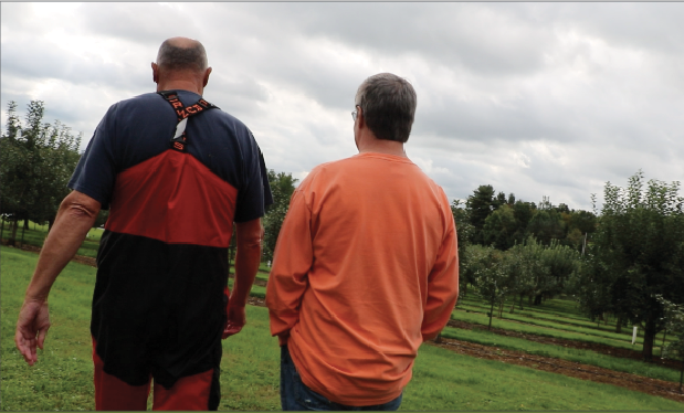 Jeff Davenport and Jeff Boswell walk  through the orchard at  Davenport Fruit Farm  Cidery and Winery on  Saturday, Sept. 29, 2018.