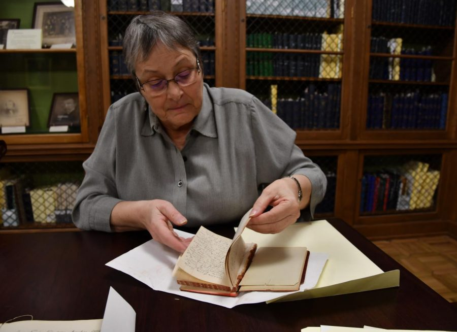 Jane Westenfeld, research and Special Collections librarian for the Lawrence Lee Pelletier Library, flips through a diary Ida Tarbell kept in 1905 and 1906 on Oct. 29, 2018. Westenfeld said the Ida Tarbell Collection at the college's library contains more than 17,000 items.