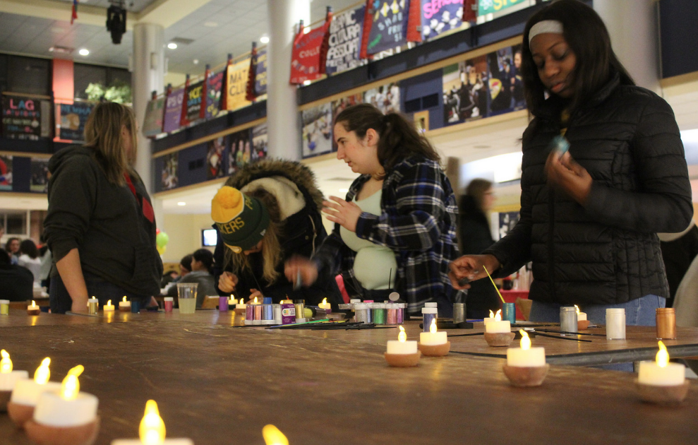 Students light candles in Henderson Campus Center to celebrate Diwali on Nov.13, 2018.