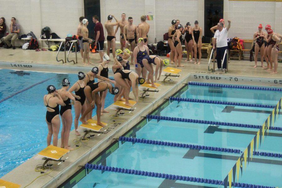 Allegheny women prepare to swim a relay against teams from Edinboro University and Gannon University on Friday, Nov. 9, 2018.