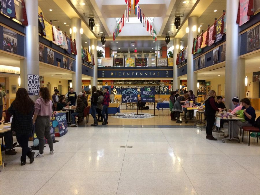 Students gather in the lobby of the Henderson Campus Center for the 2018 Spiritual and Religious Life Week kick-off event, the Midwinter Festival, on Saturday, Jan. 27, 2018.