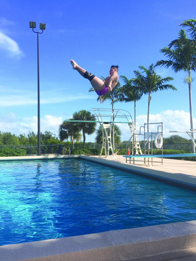 Hunter Pietrzycki, '21, practices a dive in Florida International University's diving well during the team's January training trip. Pietrzycki has brought the Gators five first-place finishes during the 2018-19 season.