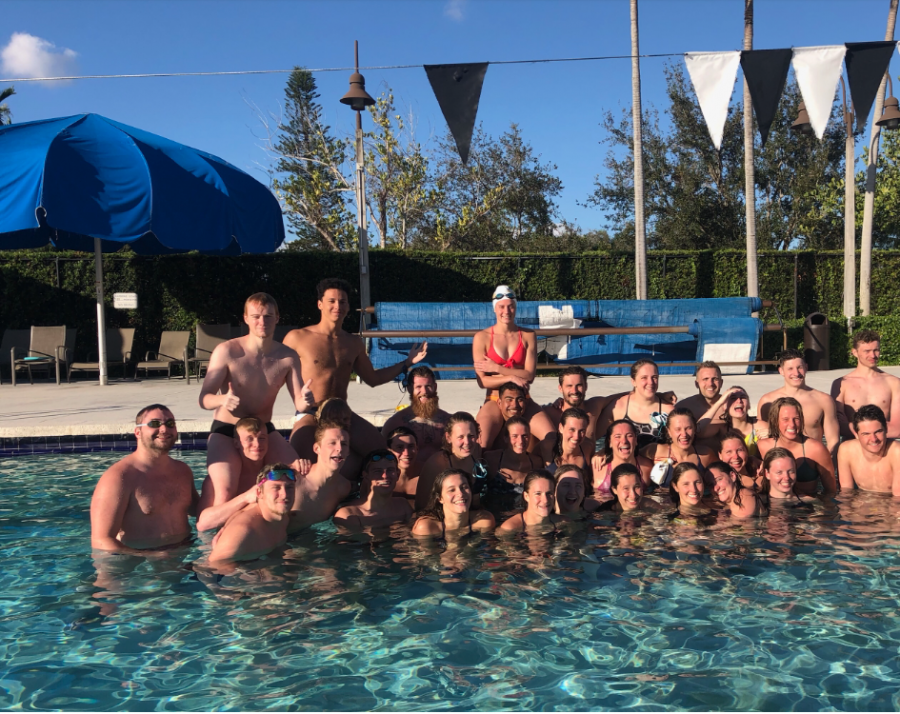 The+swim+and+dive+team+smiles+during+a+break+in+training+at+Florida+International+University.+The+team+spent+a+total+of+eight+days+practicing+in+Miami%2C+Florida.