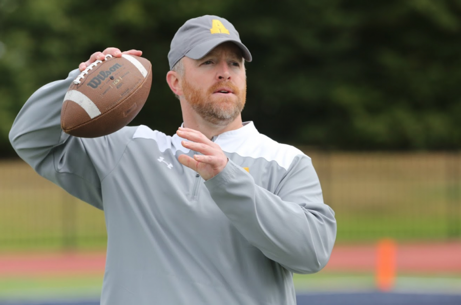 Former head football coach William Hammer throws a football during team practice. Officially named to staff in January of 2016, Hammer has spent three football seasons at Allegheny College. Hammer was the football program's 34th coach and will be moving on to a new position at Bowdoin College in Brunswick, Maine.