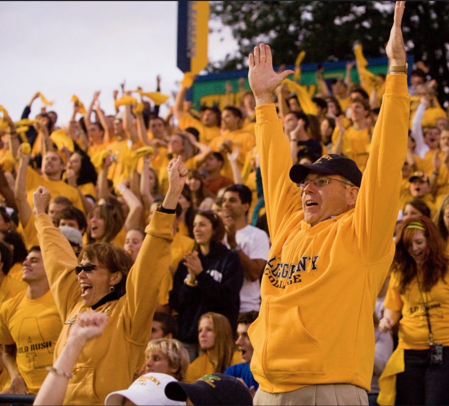 James and Mari Mullen cheer during an Allegheny College football game in 2010 at the  Robertson Athletic Complex Football Stadium.