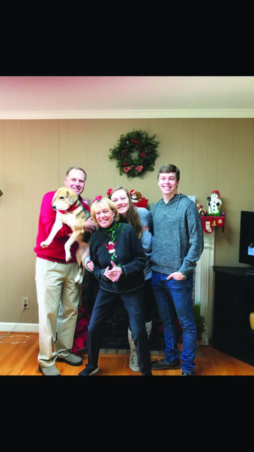 The Mullen family poses for a Christmas photograph in 2017.