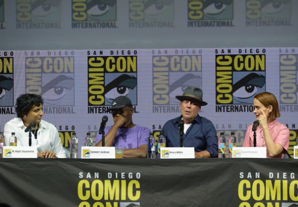 "M. Night Shyamalan, Samuel L. Jackson, Bruce Willis and Sarah Paulson speak at a ""Glass"" panel on July 20, 2018, at Comic-Con International in San Diego, California."