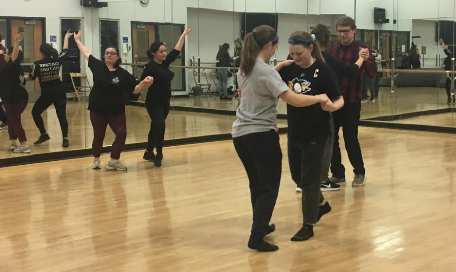 Gabrielle Ramos, '20, leads students in learning the salsa.