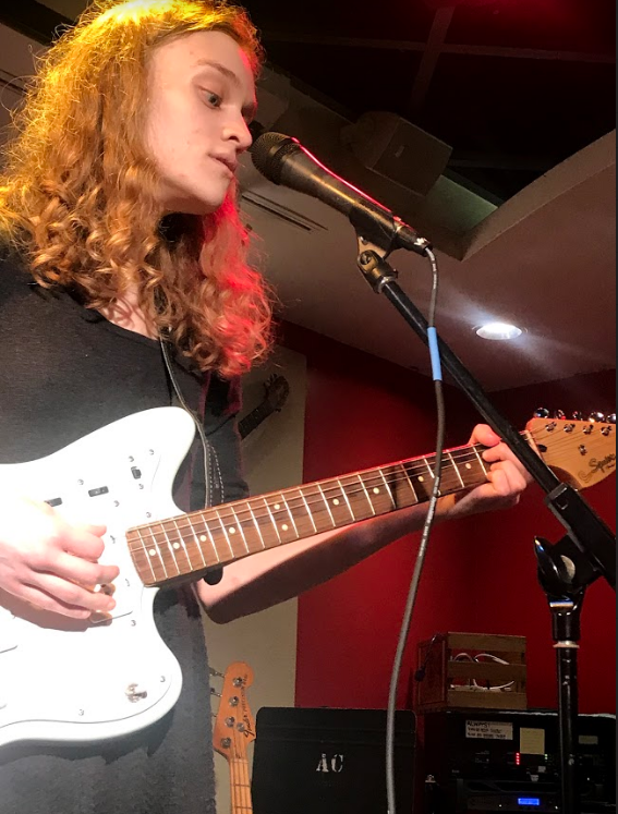 Aubrey Collins, ' 19, opens for Bad Bad Hats on Friday, Feb. 22, 2019, in Grounds for Change.