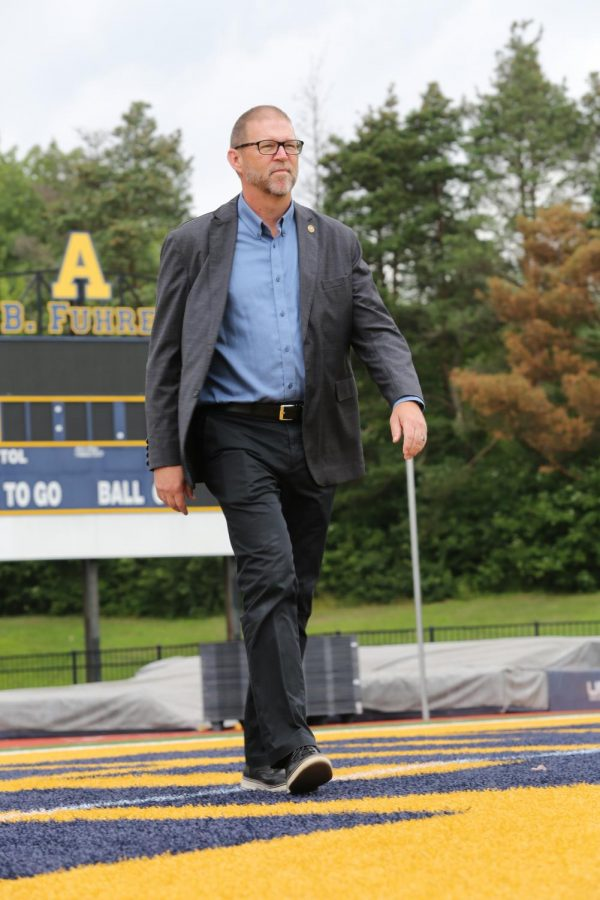 Ross walks across the Frank B. Fuhrer Field at the Robertson Athletic Complex.