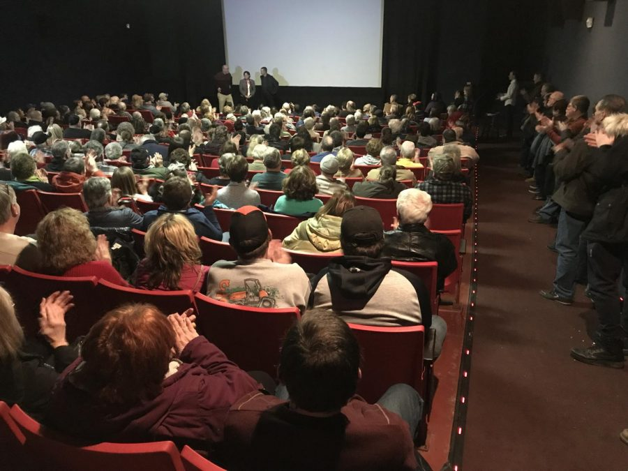 A full auditorium at Park Avenue Cinema applauds after the premier of Michael Keeley's documentary, 'This is a Cemetery: Greendale,' which was screened at 7 p.m. Thursday, Feb. 28, 2019.