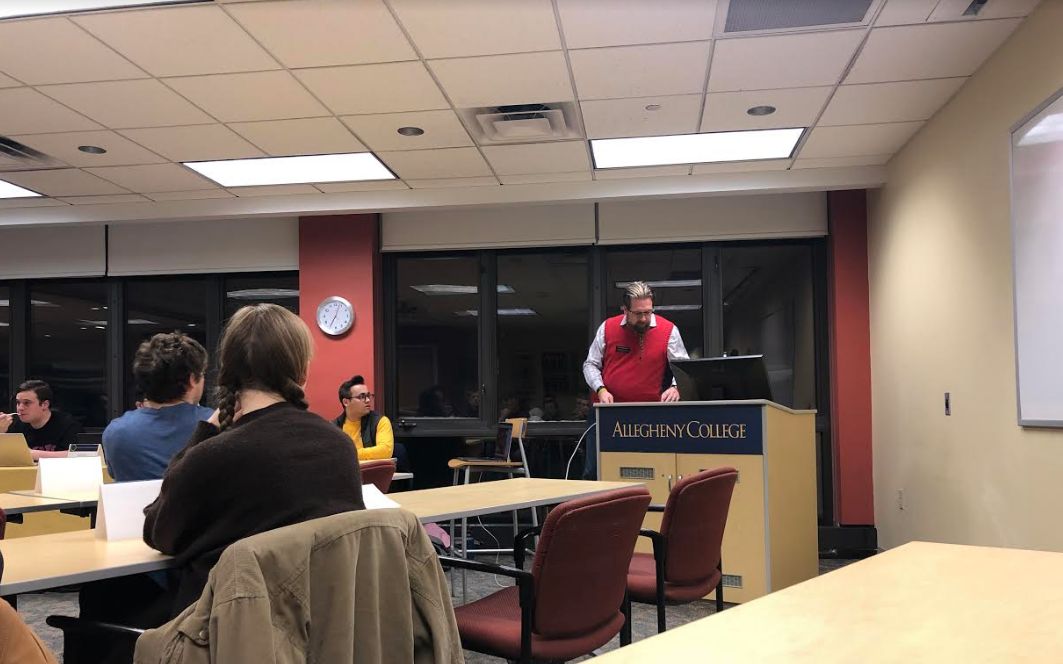 Registrar Ian Binnington speaks about changes to Allegheny College's daily grid schedule  during Allegheny Student Government's general assembly meeting Tuesday, March 5, in room 301/302 of the Henderson Campus Center.