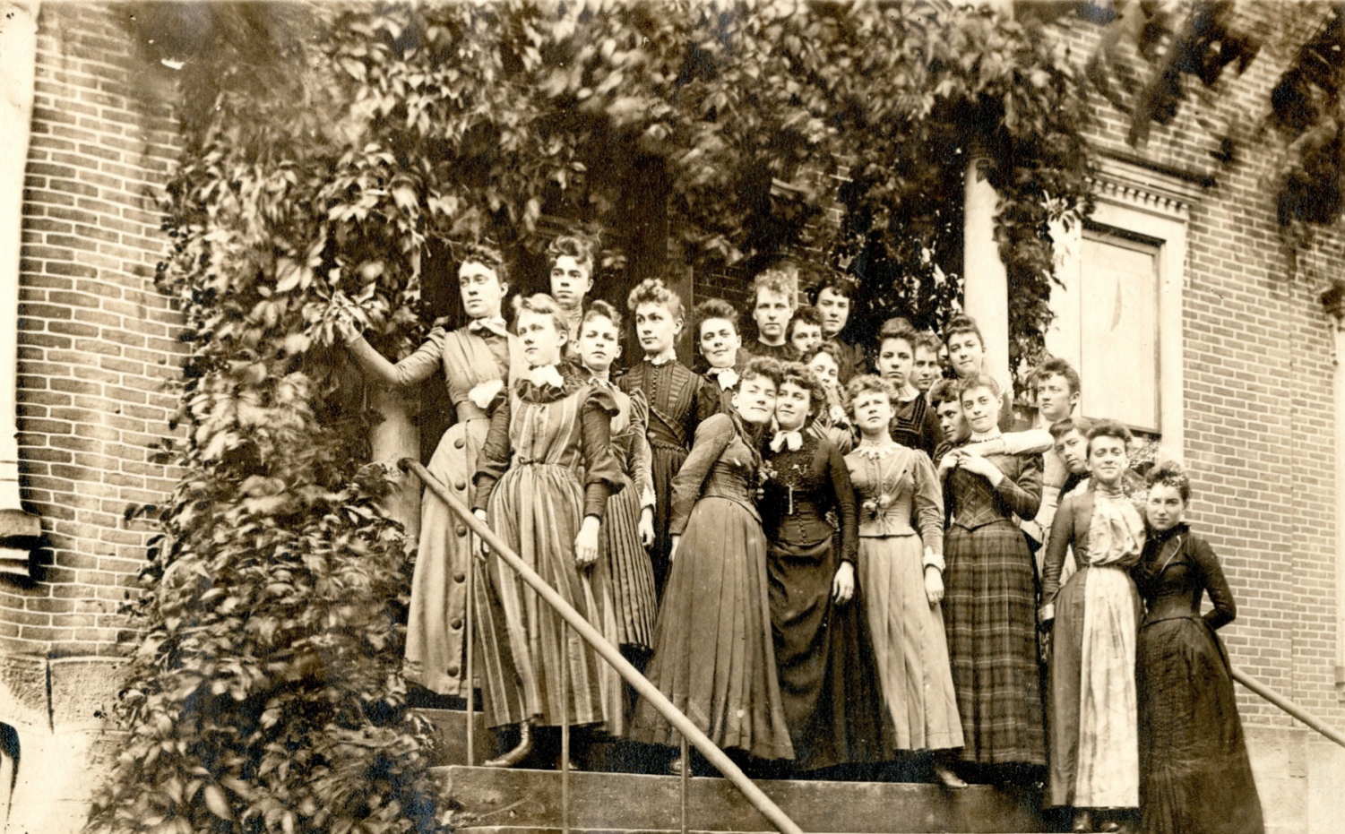 A group of students stand on the steps of Hulings Hall in 1890.