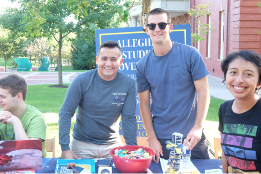 David Roach '21, and Brandon Zabo, '22, hand out information and candy to students interested in joining Allegheny Student Government on Aug. 29, 2019.